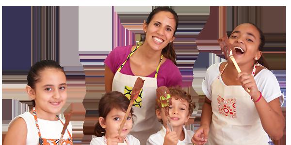 Malu Petty e crianças cozinhando